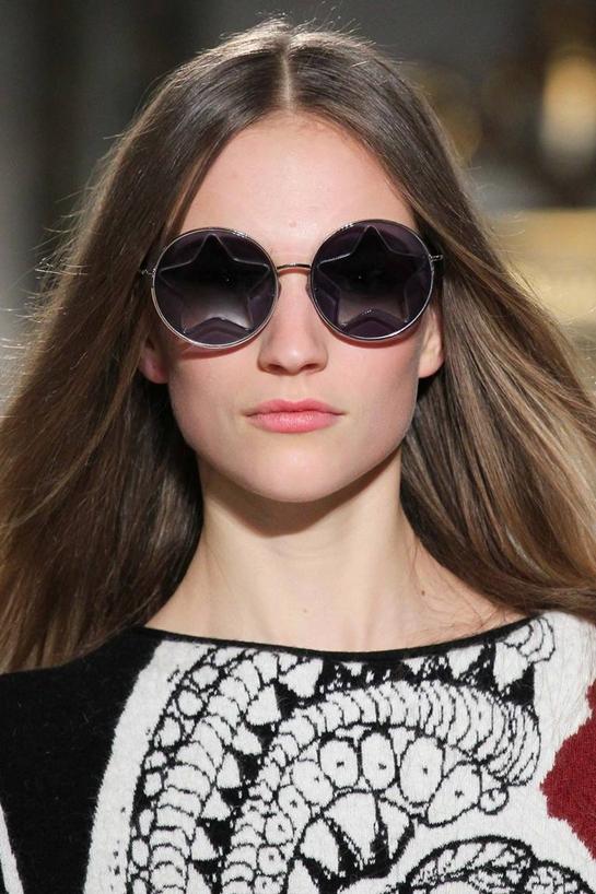 Модные солнцезащитные очки закругленной формы